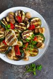 Salad with grilled vegetables and mushrooms. Vegetable salad with grilled champignons. Grilled salad Royalty Free Stock Photo