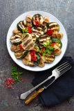Salad with grilled vegetables and mushrooms. Vegetable salad with grilled champignons. Grilled salad Stock Photos