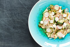 Salad - grilled zucchini 'tagliatelle', feta cheese, radish and red onion slices Royalty Free Stock Image