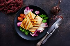 Salad with halloumi. Grilled Halloumi Cheese salad with fresh vegetables Royalty Free Stock Photography