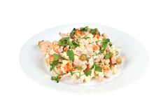 Salad with ham. Potatoes, peas, carrots, mayonnaise and parsley image isolated on a white background Stock Images