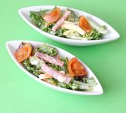 Salad with ham and cheese Stock Images