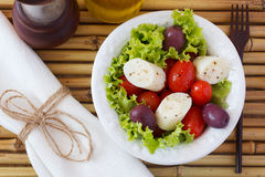 Salad of heart of palm (palmito), cherry tomatos, olives, black Stock Photography
