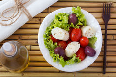 Salad of heart of palm (palmito), cherry tomatos, olives, pepper Royalty Free Stock Images