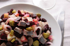 Salad with herring. Salad made of herring, boiled potatoes, boiled beet, fresh onion and pickled cucumbers Stock Images