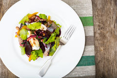 Salad with herring, beetroot, paprika, red onion, mustard and ba royalty free stock photo