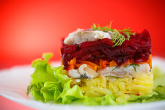 Salad with herring and boiled vegetables Stock Photo