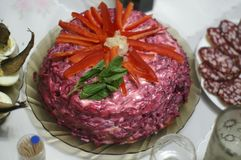 Salad `herring under a fur coat`, decorated with slices of sweet pepper. royalty free stock image