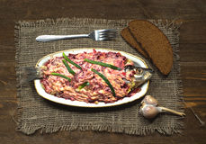 Salad herring under a fur coat on a wooden table in the backgro Royalty Free Stock Image
