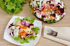 Salad with herring and vegetables Stock Image