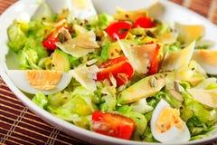 Salad with iceberg, cherry tomato and avocado royalty free stock photography