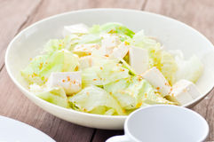 Salad. Iceberg lettuce and tofu salad dish Royalty Free Stock Image