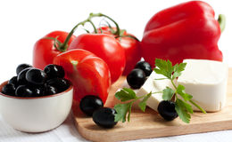 Salad ingredients- fresh vegetable and feta cheese. Tomatoes, olives, peppers and feta cheese. Salad ingredients. Healthy food Royalty Free Stock Photography