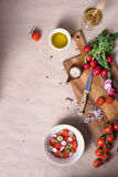 Salad ingredients. Healthy cooking background. Fresh tomatoes with radishes and spices. Top view, copy space. Stock Images