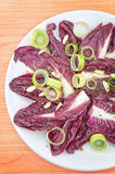 Salad with italian radicchio. Onion and pine nuts Stock Photo
