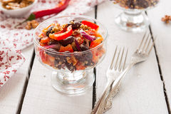 Salad from kidney bean, meat and walnut Royalty Free Stock Images