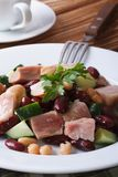 Salad with kidney beans, meat and fresh cucumber close-up Stock Photography