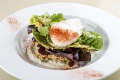 Salad with kino, avocado and poached egg stock image