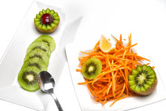 Salad with kiwi and carrots. Kiwi. A great healthy fruit full of vitamins Royalty Free Stock Photography