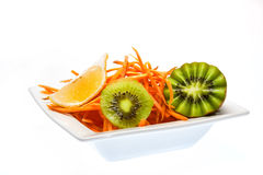 Salad with kiwi and carrots. Kiwi. A great healthy fruit full of vitamins Stock Image