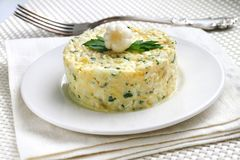 Salad with krill meat. Canned pineapple, eggs, cheese, parsley and mayonnaise Stock Image