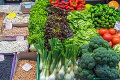 Salad and legumes for sale. At a market royalty free stock images