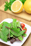 Salad and lemon Royalty Free Stock Photography