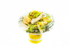 Salad with lemon. Dietary salad with lemon on white background royalty free stock photography