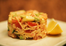 salad and lemon on white plate Stock Image