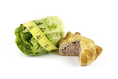 Salad Lettace with Pork Pie and Tape Measure Stock Photos