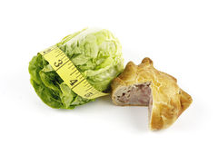 Salad Lettace with Pork Pie and Tape Measure Royalty Free Stock Image