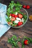 Salad of lettuce, arugula, strawberries, feta cheese stock photography