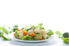 Salad of lettuce, cauliflower and Brussels sprouts with a pumpkin Stock Images