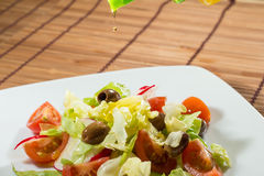 Salad of lettuce and cherry tomatoes Stock Photo