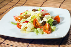 Salad of lettuce and cherry tomatoes Stock Photography