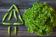 Salad lettuce and green peas healthy organic Royalty Free Stock Image