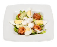 Salad with lettuce, marinated salmon, mozzarella balls, egg, oli Stock Photo