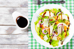 Salad with lettuce, pear,  grilled chicken breast, walnut, parmesan cheese, cranberry Stock Photo