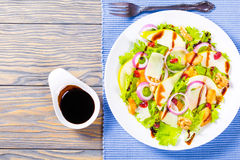 Salad with lettuce, pear,  grilled chicken breast, walnut, parmesan cheese, cranberry Royalty Free Stock Photo