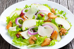 Salad with lettuce, pear,  grilled chicken breast, walnut, parmesan cheese, cranberry Royalty Free Stock Image