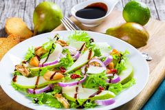 Salad with lettuce, pear,  grilled chicken breast, walnut, parmesan cheese, cranberry Royalty Free Stock Images