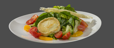 Salad of lettuce with zashecheno goat cheese and parmesan cheese Stock Image
