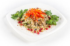Salad with liver and pomegranate. On white plate Royalty Free Stock Images