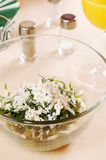 Salad made of fresh tarragon and grapes. In a glass dish Stock Photo