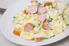 Salad made of potato, cucumber, onion with sausage Stock Photography