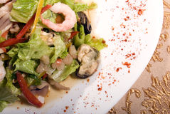 Salad made of seafood. Salad made of different seafood and vegetables stock photography