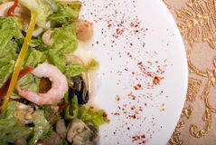 Salad made of seafood. Salad made of different seafood and vegetables royalty free stock photo