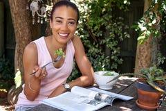 Salad magazine woman Stock Photo