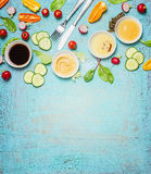 Salad making. Cutlery and dressing ingredients for fresh salad on light blue background, top view place for text. Stock Photos