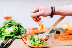 salad making of details. Professional cook master chef preparing special salad with carrots and vegetables Stock Photos